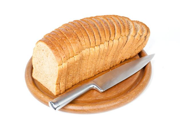cutting large pieces of bread