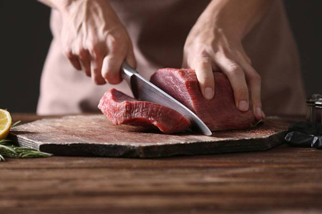 cutting large pieces of meat